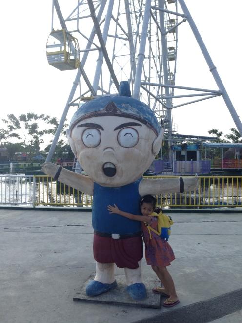 Hugging the park mascot